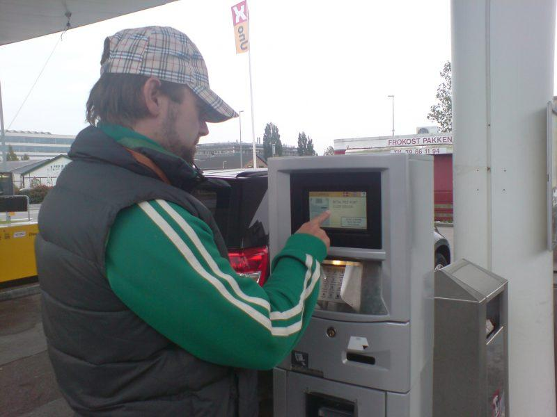 Customer using touch screen system at Tolkheim petrol station