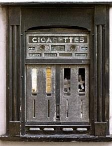 An old cigarette vending machine located in Hay on Wye