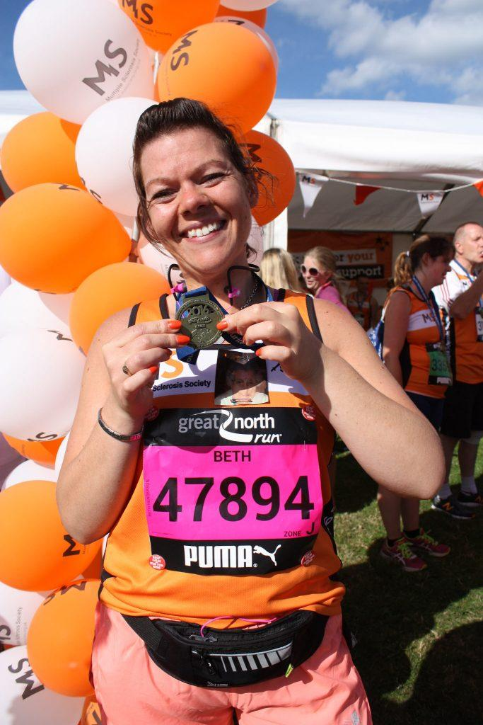 Beth Henderson from the ZytronicTeam showcasing her medal from the Great North Run