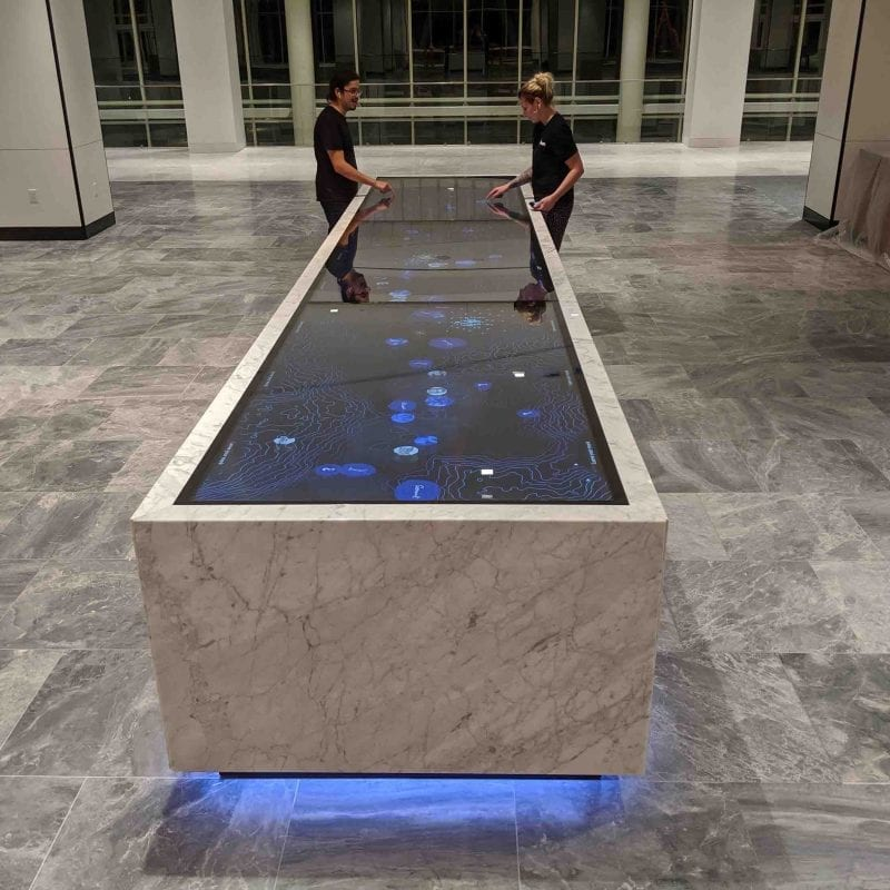Interactive multi touch table welcomes visitors to corporate headquarters